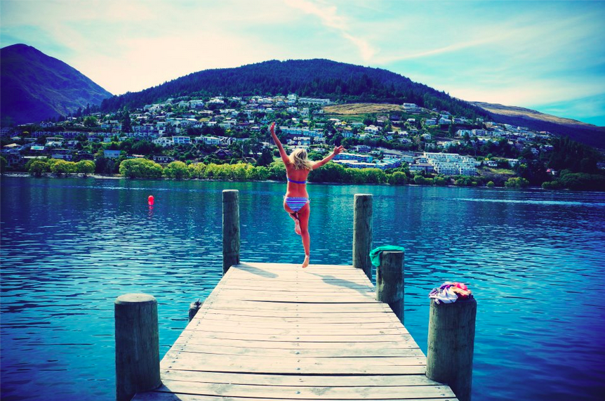 jumping into a lake new zealand queenstown