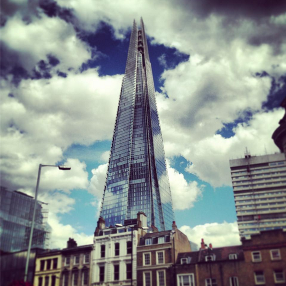 London shard sunshine clouds